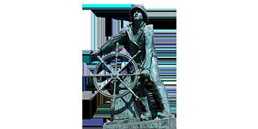 Symbolbild: Steuermann am Steuerrad